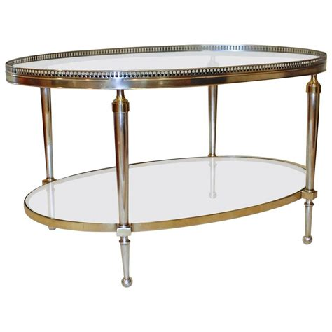 silver and brass oval cocktail coffee table at 1stdibs