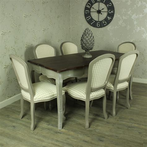 large grey dining table   padded dining chair