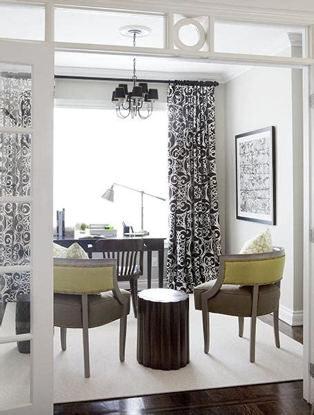 in a white room with black curtains black and white curtains contemporary den library