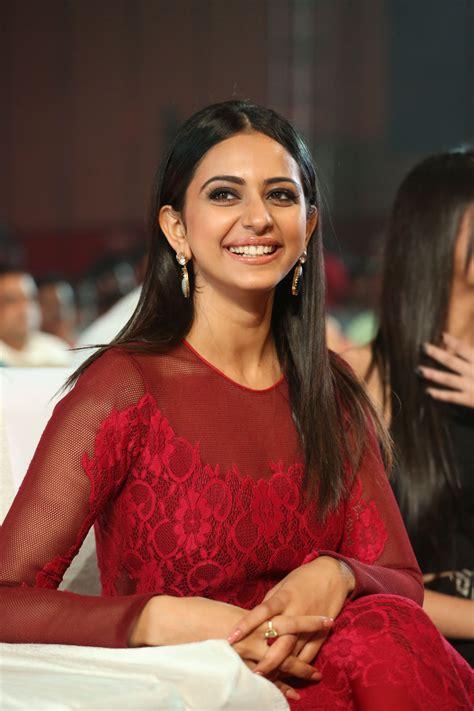 sarinodu movie only rakul preet sing photos rakul preet sing in gorgeous maroon transparent gown hot