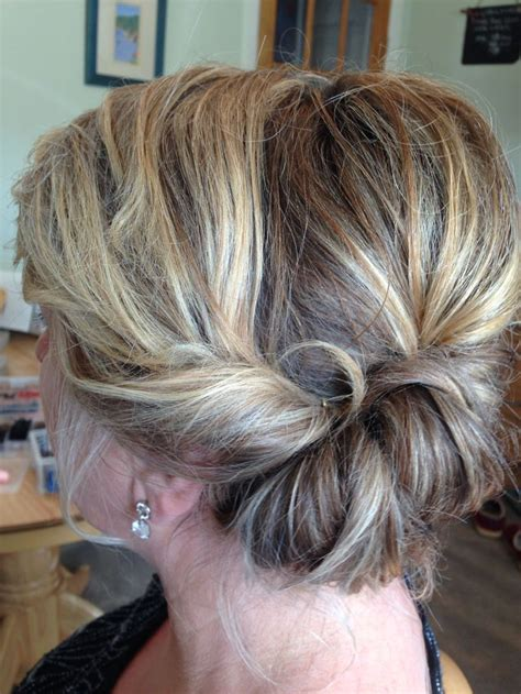 soft updo hairstyles for mothers roll to the side twist mother of the bride loose updo