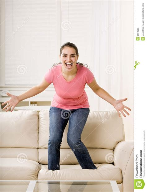 no jumping on the couch young woman jumping on couch stock photo image 6604850