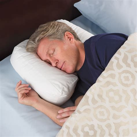 Sleeper Pillow by The Side Sleeper S Ergonomic Pillow Hammacher Schlemmer