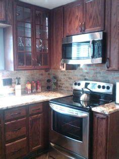 exposed brick kitchen backsplash backsplash pinterest 1000 images about backsplashes and countertops on