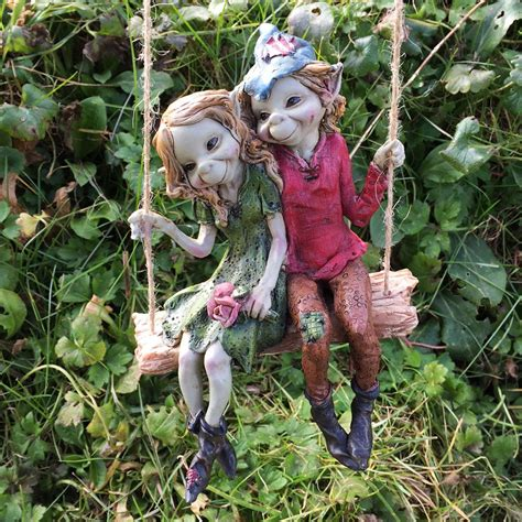 outdoor pixie elves pixie on a swing sculpture by tony fisher prezents