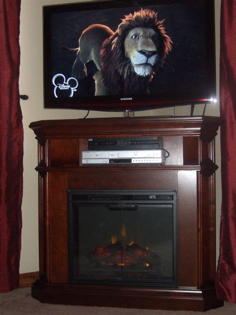 corner media cabinet with fireplace and media console gallery