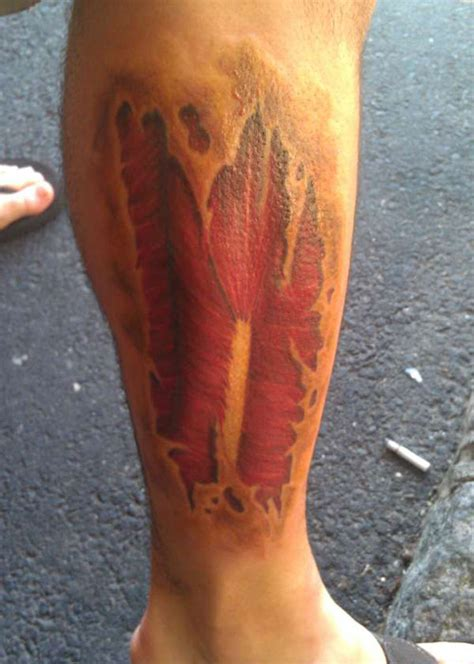 calf muscle tattoo ripped skin on forearm