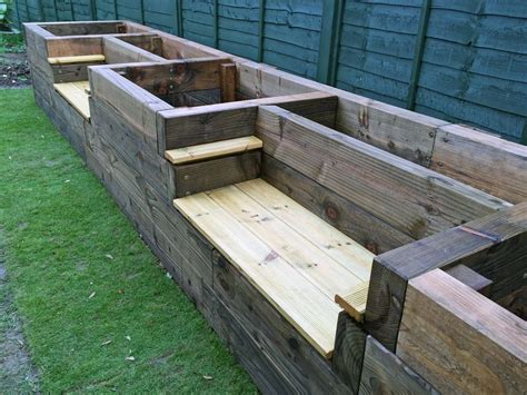 Les Mable's raised beds with bench seats from new railway