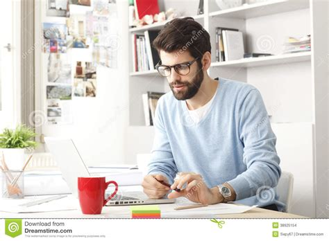 working at home portrait of young modern businessman stock photo image