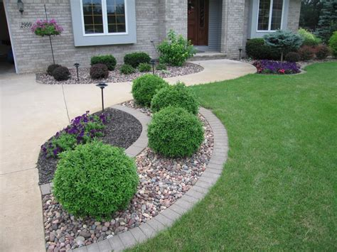 welcoming entrance with a symmetrical landscape design