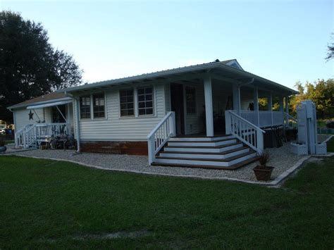 wrap around porch steps to door covered deck and open dreamy double wide