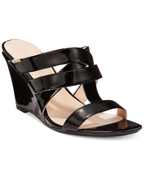 calvin klein wedge sandals calvin klein s nona wedge sandals in black lyst