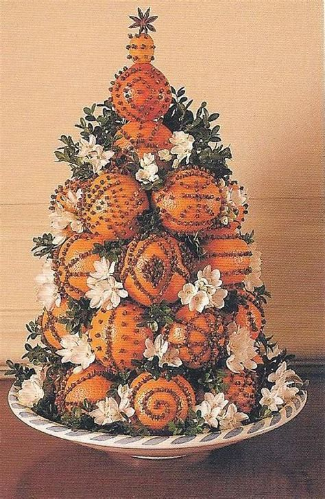 christmas trees that smell like orange a dramatic cone designed with clove studded naval oranges topped with a kumquat is not only