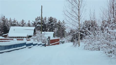 wooden russian house in winter covered with snow stock camera moving at wooden fence of timber house in village