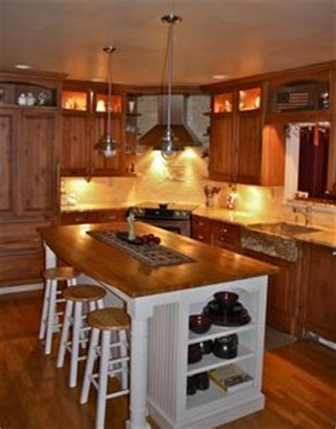 1000 ideas about corner stove on stoves cherry cabinets and cabinet lighting