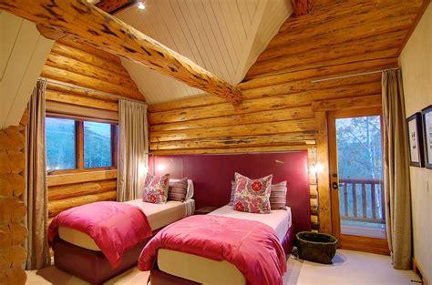 rustic log retreat blends modern accents  spectacular views