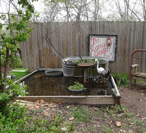 backyard pond made with tarp and raised garden bed kit