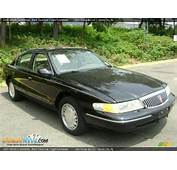 1997 Lincoln Continental Black Clearcoat / Light Parchment Photo 7