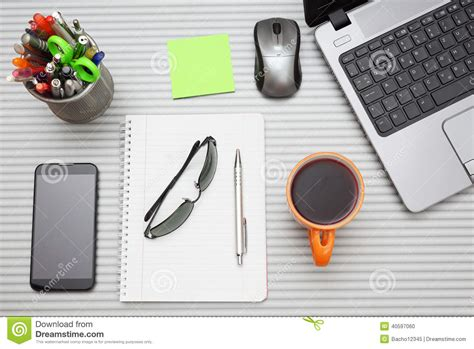 Office Desk With Laptop With Business Accessories And Cup Business Desk Accessories