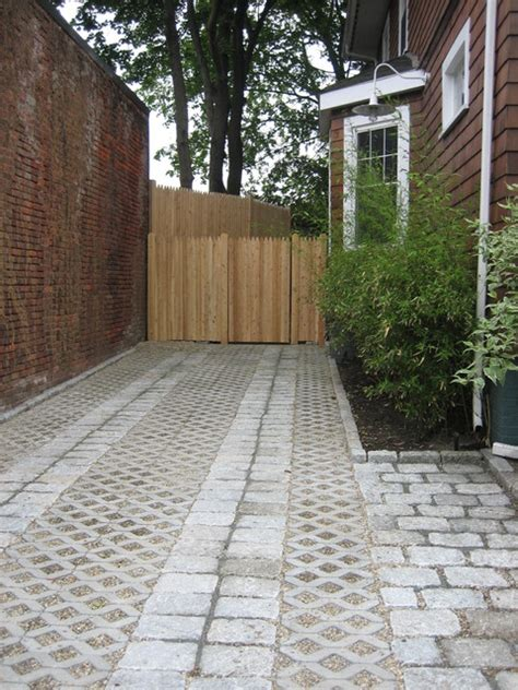 cobblestone and pea gravel driveway traditional landscape boston by nilsen landscape