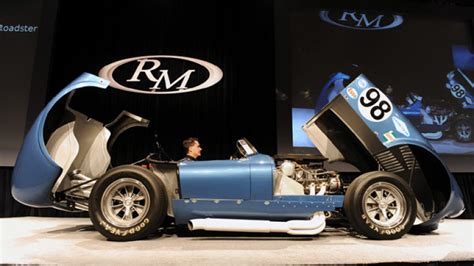 shelby cobra flip top fails  meet reserve  rm auction autoblog