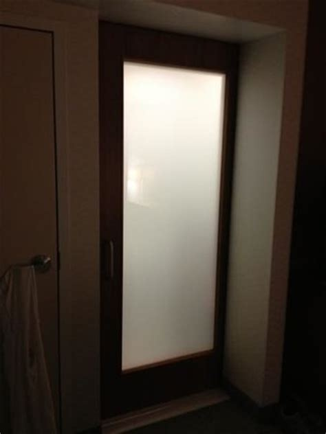 frosted glass bathroom doors makes it difficult for