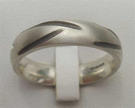 silver rings made love2have in the uk