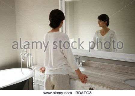 chinese family in our bathroom two men holding hands some bathroom stalls stock photo