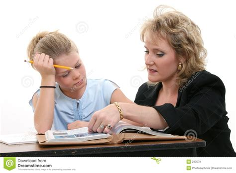 Teacher Helping Student At Desk Royalty Free Stock Images Student At Desk