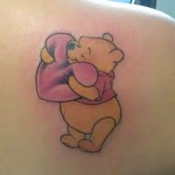 cuddly and courageous the friendly pooh bear hugs a heart