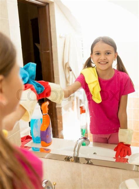 girls bathroom mirror teen girl helping at housework and cleaning bathroom