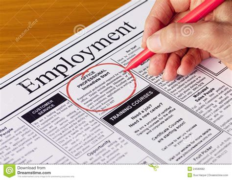 employment section of newspaper job in the employment section of newspaper stock photo