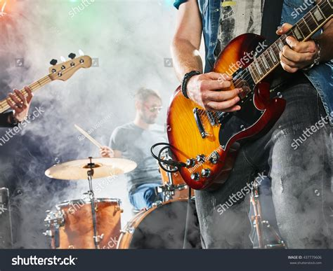 Band Guitarist rock band performs on stage guitarist stock photo