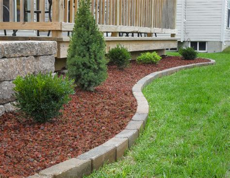 Red Lava Rock With Brick Edging Curb Appeal Pinterest Volcanic Rock Garden