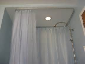 Oval ceiling track for a shower curtain