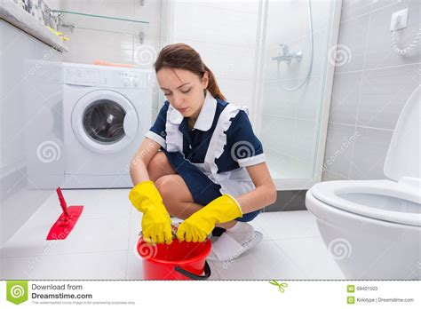 mopping bathroom floor housekeeper cleaning a bathroom floor stock photo image