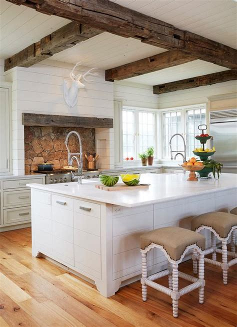 wonderful white finished large kitchen island with sink added plus country kitchen with rustic wood ceiling beams country