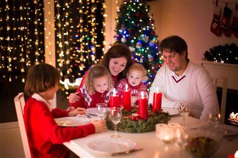 family enjoying christmas dinner  home stock image