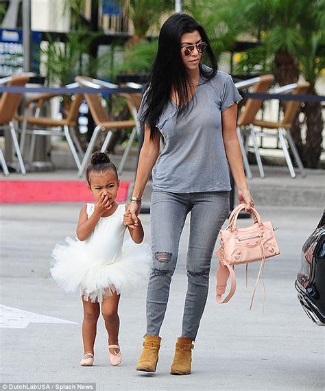 khloe kardashian comforts mom kris jenner after transwoman slam kourtney kardashian takes penelope and north to ballet