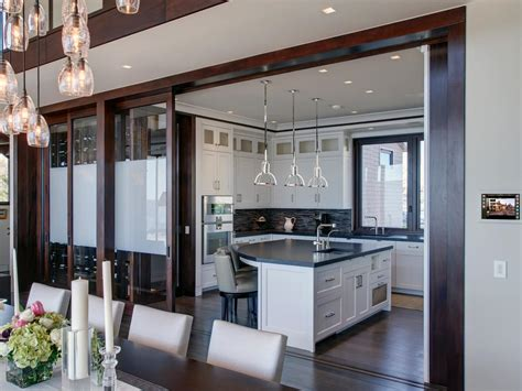 Kitchen Sliding Door by A Sleek Open Kitchen Is Connected To The Dining Room Via