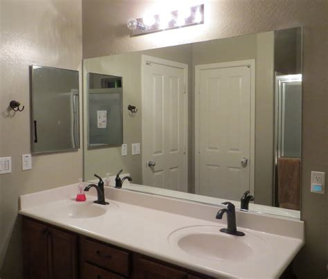 bathroom mirror wall how to frame a mirror the builder s installed a mom s take