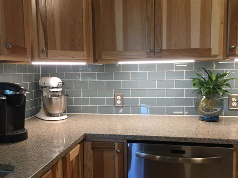 blue cabinet lighting smoky blue glass tile backsplash and cabinet
