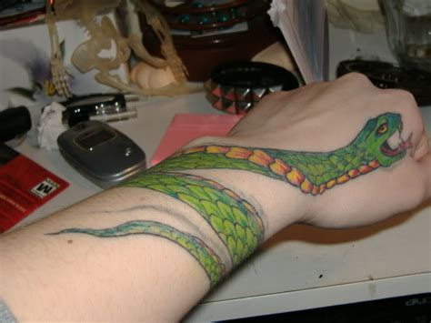 snake wrapped around arm tattoo snake wrapped around wrist www pixshark