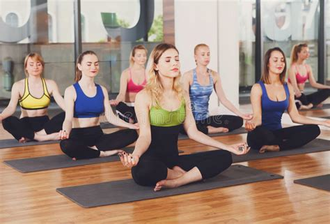 yoga relax tutorial group of young women in yoga class stock image image of