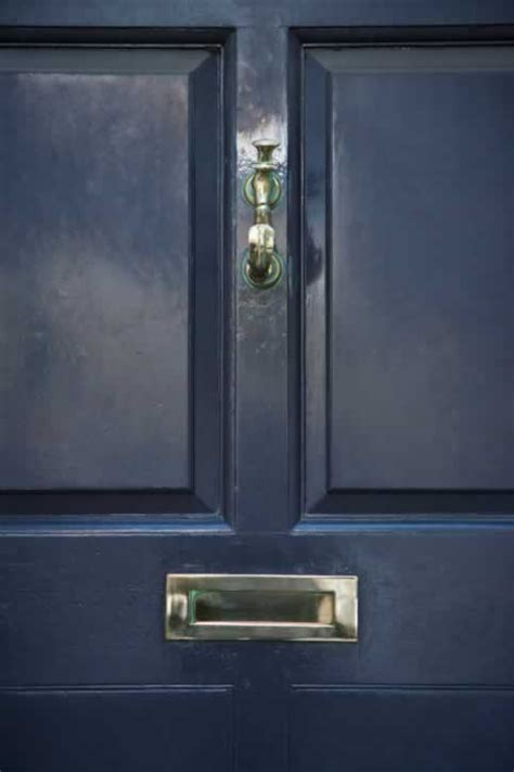 Mail Slots For Doors by Black Wooden Raised Four Panel Door With Brass Knocker And