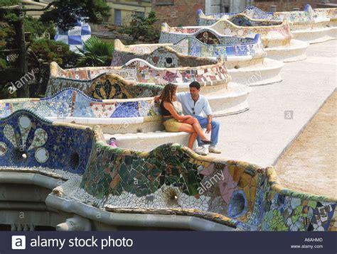 gaudi bench couple sitting on bench of mosaic artwork by antonio gaudi