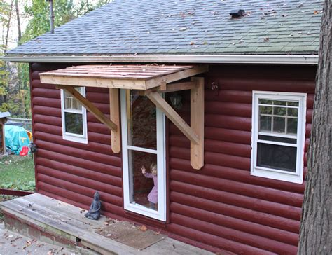 homemade door awning roof overhang without posts ideas on how to pull this off