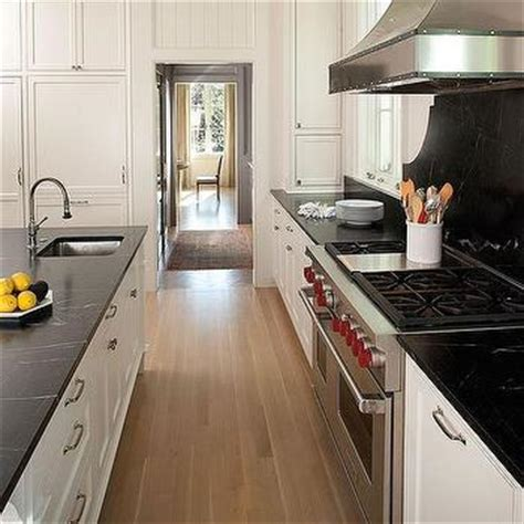 White Soapstone Countertops by White And Black Kitchen Backsplash Tiles With Wood Shelves
