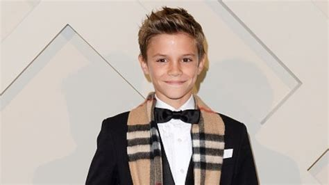 romeo beckham hairstyle romeo beckham debuts a very different hairstyle her ie