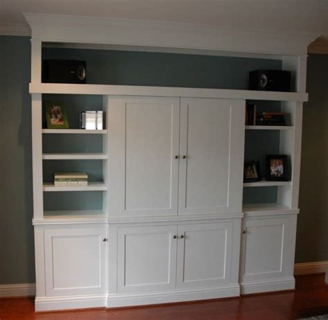 hand crafted painted built in tv cabinetry by tony o hand made custom entertainment center with sliding doors